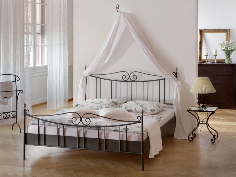 metal-bed-with-talu-curtain-holder.jpeg