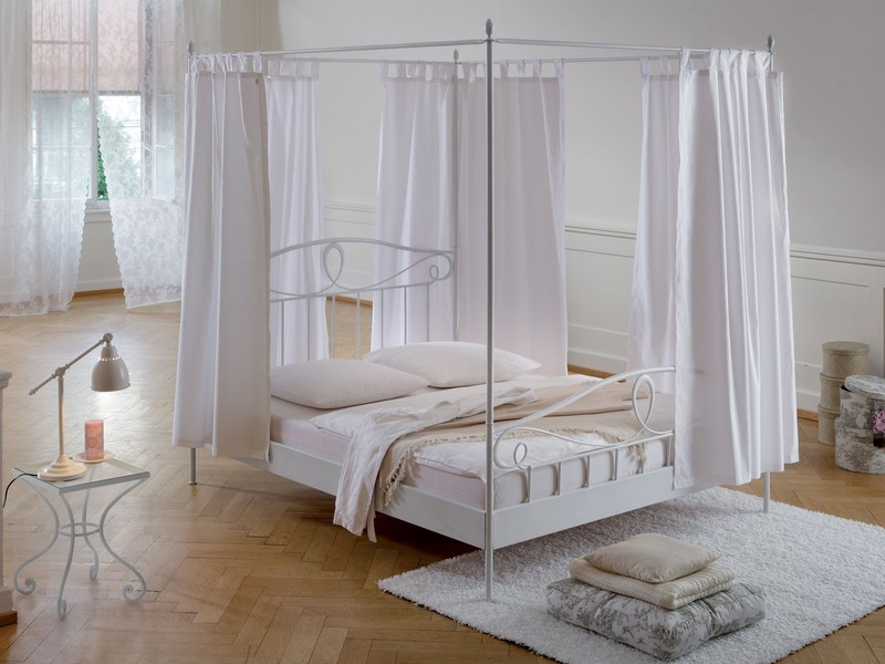 nice-white-wrought-iron-bed-frames-with-white-clean-bed-sheet-and-white-curtain-also-unique-table-lamp-plus-natural-wooden-floor-for-style-beige-bedroom-design-ideas-antique-wrought-iro.jpeg