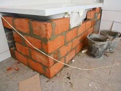 136104338-installing-bathtub-bathtub-installation-with-bricks-in-house-bath-room20201029-48144-wrzljr