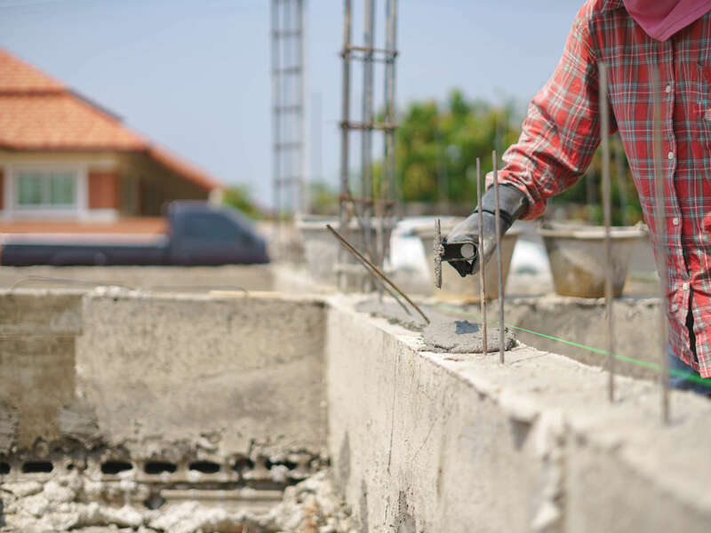 worker-labor-building-wall-with-concrete-cement