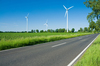 a road and wind farms in the countryside