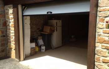 Rénovation porte de garage sectionelle