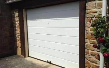 Rénovation porte de garage sectionelle
