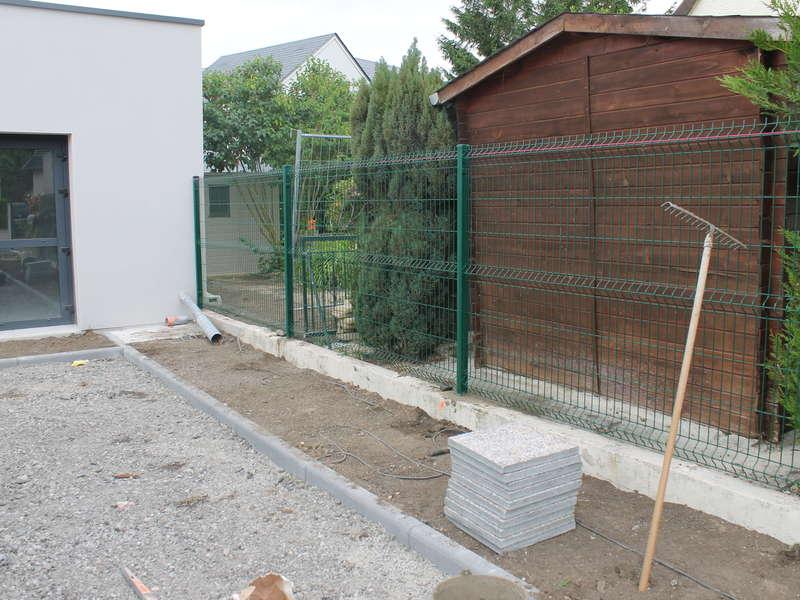 Installation d'une clôture en panneau rigide