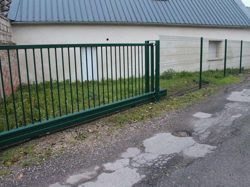 Aménagement extérieur avec création de puits perdu et passage fourreau pour portail électrique