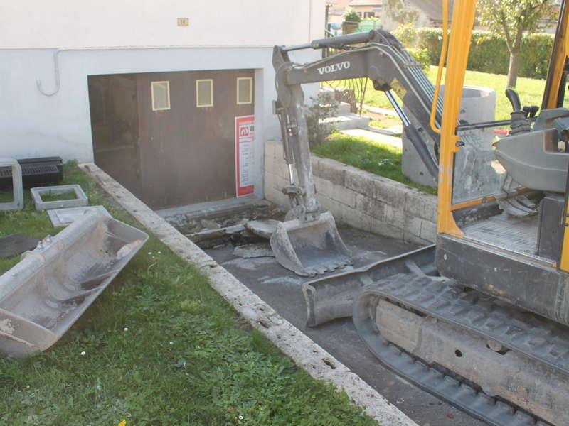 Aménagement descente de sous-sol avec création d'un  puits perdu .