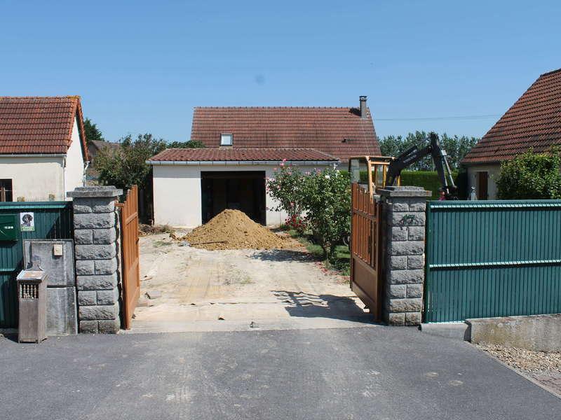 Aménagement de cour, avec création d'un puits perdu.