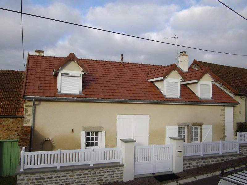 Pavillon restauré avec de la tuile Jura 10.