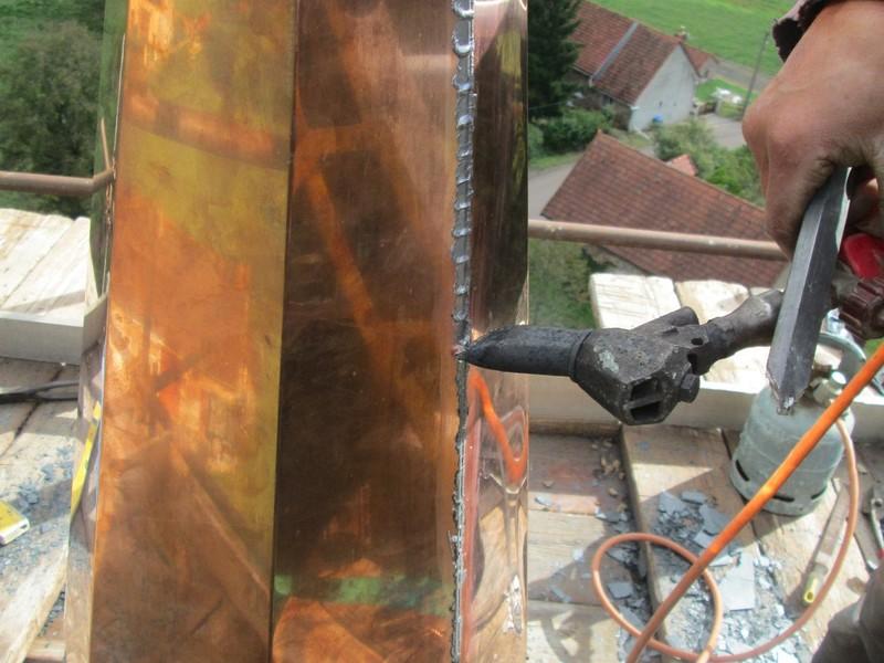 Soudure sur place d'un épi de clocher en cuivre.