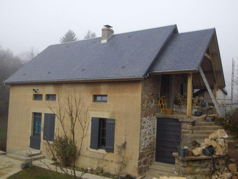 Maison couverte en ardoise de 3.5 mm.
