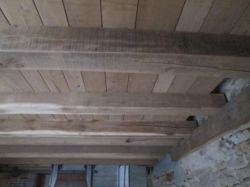 Planches en chêne brut à 3 largeurs différentes emboitées à mi bois.