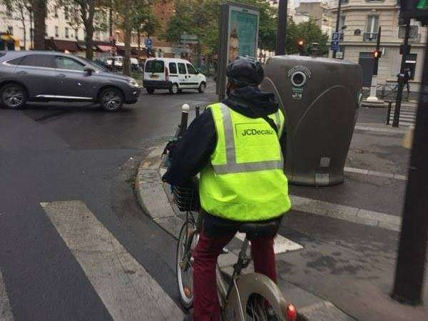 Paris - JCDecaux operates its Vélib fleet...riding Vélib!