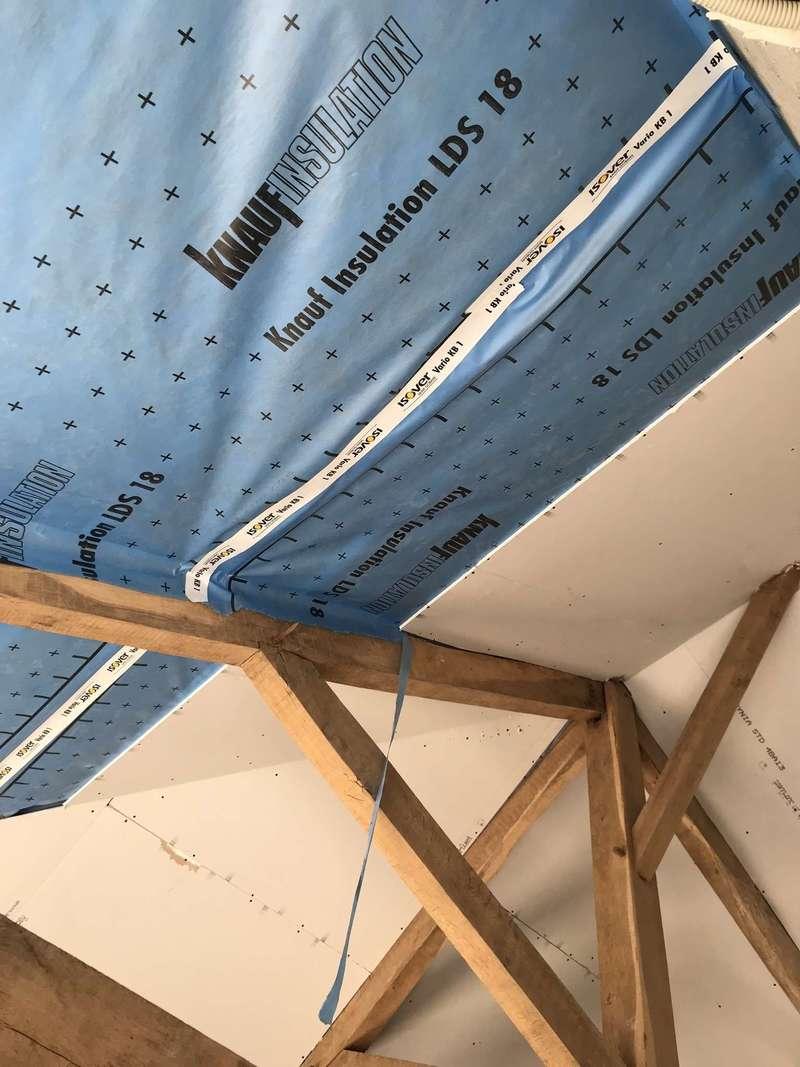 Pose de membrane apres avoir mis la laine de bois