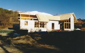 chalet ossature bois isolation en toiture par panneaux SAPISOL ép.200 menuiserie MIGUET EURE 27580 CHAISE DIEU DU THEIL