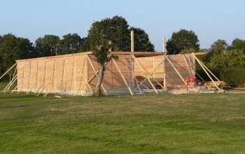 murs extérieurs composes de poteaux et madrier s en douglas menuiserie MIGUET EURE 27580 CHAISE DIEU DU THEIL